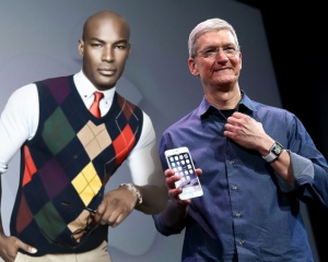 DREAM MAN: Tim Cook displaying Apple's latest offerings, the iMan, iPhone 6 and the Apple Watch